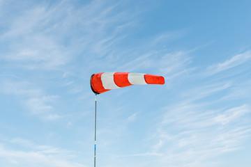 Horizontally flying windsock (wind vane) with sky
