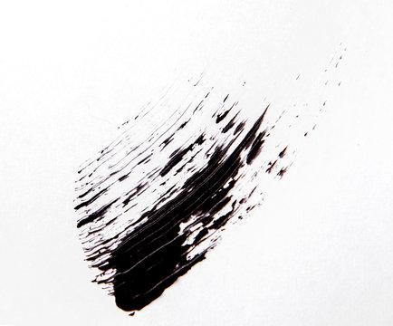 Brush strok of black shade of mascara on white