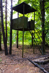 The old rickety watchtower of a soldier. Dead military unit. Consequences of the Chernobyl nuclear disaster, August 2017.