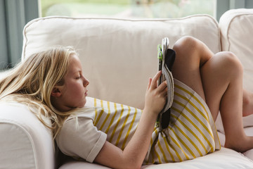Little girl using an electronic tablet device