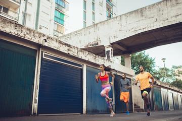 Sportswoman and Two Sporstmen Running