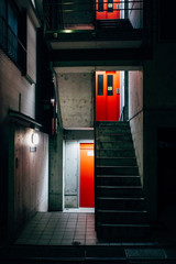 Apartment bulidling with bright red doors