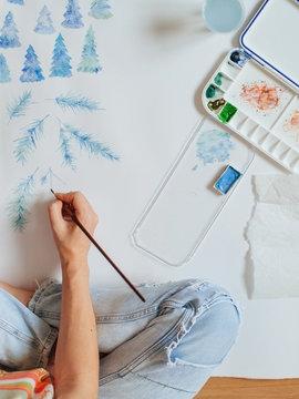 Girl artist paints watercolors