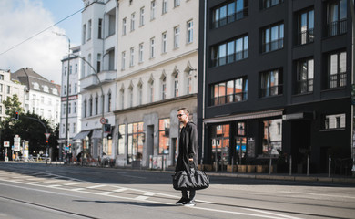 Man crossing one of the streets of Berlin