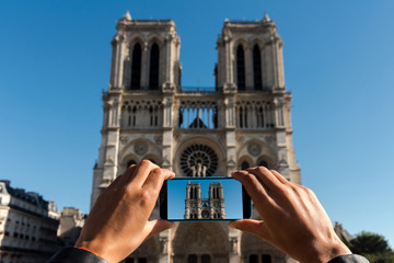 Photographing Notre Dame with a phone camera, Paris