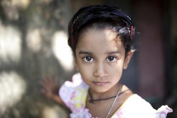 A beautiful kid looking at the camera
