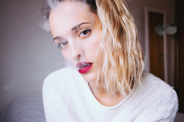 Portrait of a woman blowing smoke
