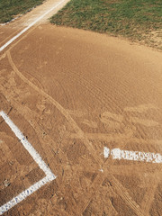 Detail of baseball field and freshly painted white boundary lines