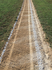 Close up of white boundary marks on baseball field