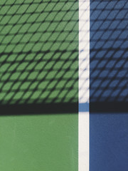 Close up of tennis court and netting shadow