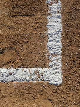 Close-up of white boundary marks on baseball field