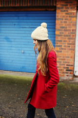 Woman walking the street in a red coat
