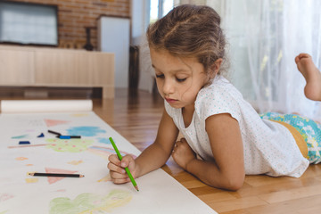 Girl drawing at home
