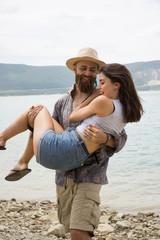 Cheerful couple on beach