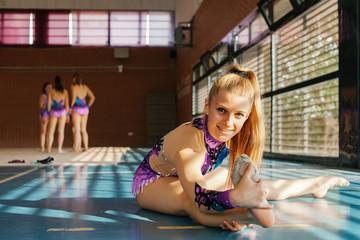 Teenage Girl Practising Rhythmic Gymnastics in the Gym