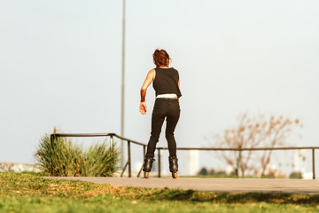 Woman skating on roller skates at a skatepark