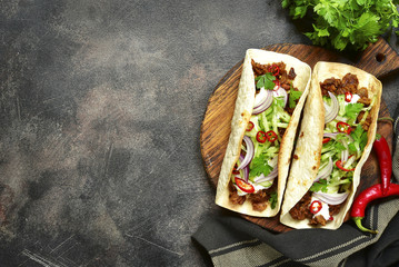 Mexican tacos with pulled beef,fresh cucumber and yogurt dressing.Top view with copy space. Wall mural