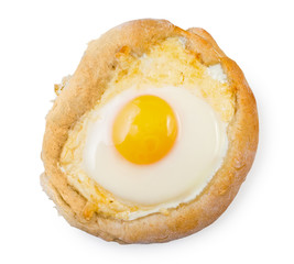 Caucasian delicious Ajarian khachapuri with egg isolated on white background, top view.