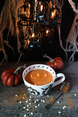 Seasonal fall pumpkin drink in Halloween setting