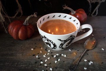 Seasonal fall pumpkin drink in Halloween setting