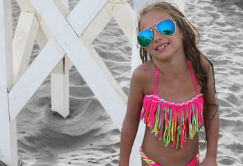 beautiful little girl in a bikini posing