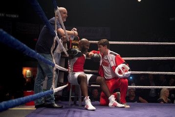 Canada's Prime Minister Justin Trudeau coaches boxer Ali Nestor during a charity event supporting in Montreal
