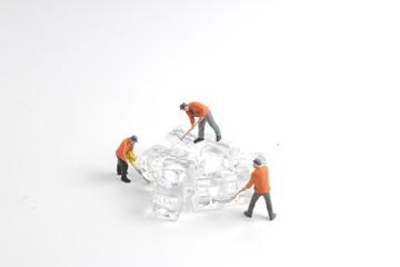 fun Mini tiny workers on ice nature