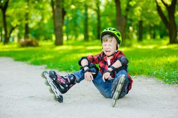 Boy crying falling on roller skates