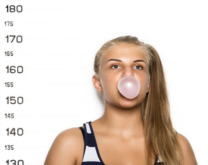 Young beautiful blonde woman chewing gum and blowing bubbles Criminal Mug Shots