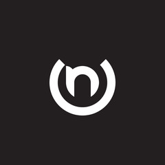 Initial lowercase letter logo un, nu, n inside u, monogram rounded shape, white color on black background