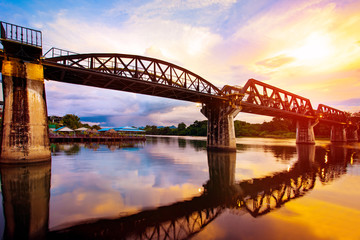 colorful twilight time of river khaw bridge in kanchanaburi most popular world war II history traveling destination in western of thailand