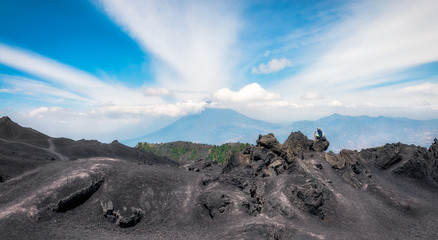 Panoramic View from the base of Volcano Pacaya in Guatemala with Volcano Agua in the background.
