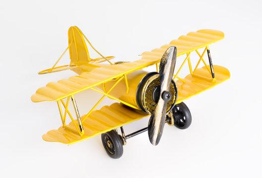 Vintage Yellow Metal toy plane on white background