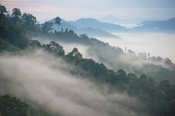 Landscape of misty mountain forest covered hills at khao khai nui