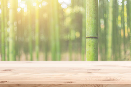 Wood foreground with blur bamboo wood forest background design for display nature products