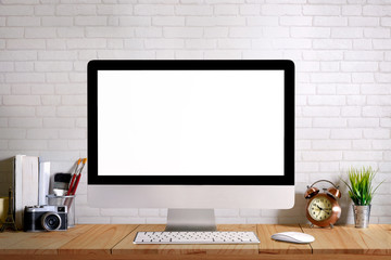 Desk space modern home decor mock up desktop computer with camera, dummy, houseplant. Artist workspace. Blank screen for graphics display montage.