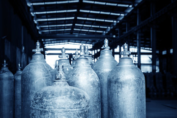 A bunch of oxygen cylinders