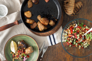 Fried meat pan with vegetable salad of black quinoa, chickpeas