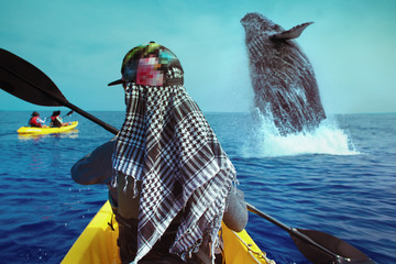 Whale watching travel adventure. Woman Paddling on yellow canoe in open water of blue ocean. View from back on sea surface.