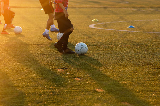 Youth training football in the football practice field. Sport concept.