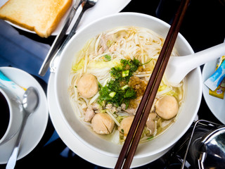 Asian cuisine, rice noodles with pork ball.