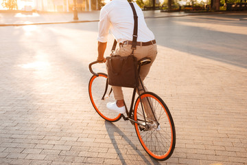 Handsome young african man early morning with bicycle