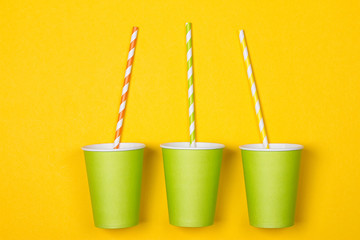 bundle of multi-colored drinking straws in a paper Cup