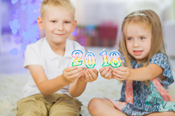 Children boy and girl holding new year 2018