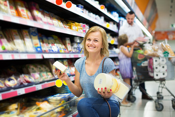Woman holding variety of cheese