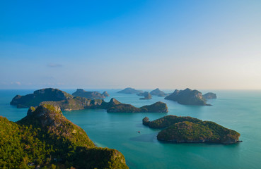 A high angle beautiful view of Angthong Islands National Park in Surat Thani, Thailand with reflection of bright and clear blue sky. Beautiful sea at gulf of Thailand at Angthong Islands.