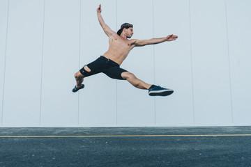 Sportive man dancing at street