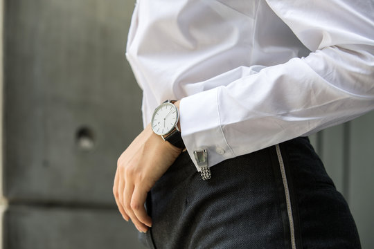 Image of woman hand at business suit wearing white shirt with cufflinks and watch resting her hand