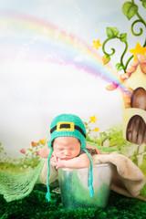 Sleeping newborn baby in a St. Patrick's Day hat