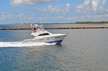 Sport fishing boat returning to port at the Miami Beach marine